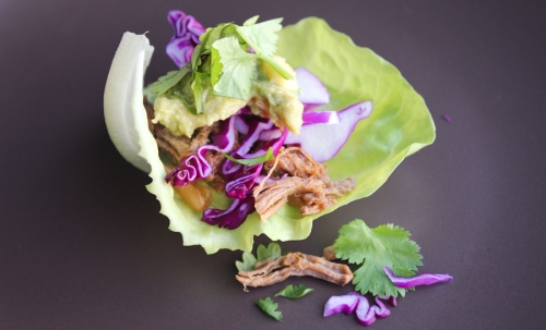 Carne asada lettuce wraps with guacamole and red cabbage